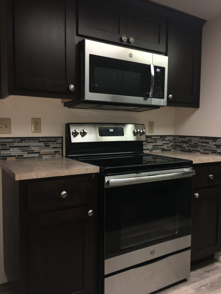 Bon Dark Stained Clear Alder Was The Wood And Finish For This Seattle Remodel.  The Dark Colored Cabinets With The Stainless Appliances Accent Eachother  Nicely.